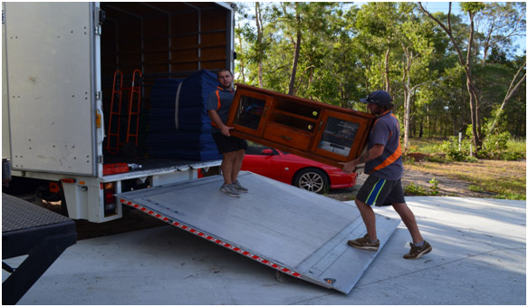 Two professional removalists loading one of our removal trucks in Brisbane