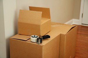Three boxes with taping on top.
