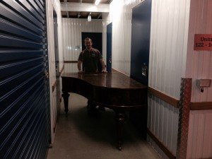 Platinum finishing a Caloundra removals job, by storing a piano.
