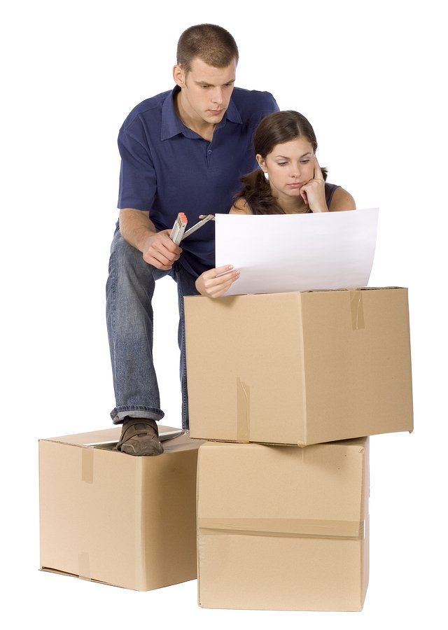 Couple with packing boxes ready for removalists Sunshine Coast.